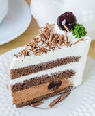 Chocolate cake with black cherry — Stock Photo