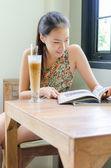 Girl in coffee shop — Stock Photo