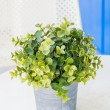Stock Photo: Plastic flowers in vase