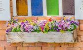 Plastic flowers in vase — Stock Photo