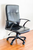 Black leather office chair — Stock Photo