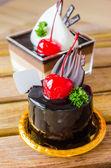 Chocolate cake with cherry — Stock Photo