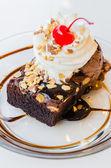 Chocolate brownie icecream and cherry — Stock Photo