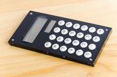 Calculator on wood table — Stock Photo