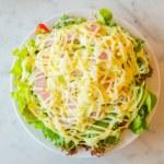 Salad in white bowl — Stock Photo