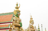 Giant statue in emerald temple — Stock Photo