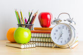 Note books , clock , pencils , apples — Stock Photo