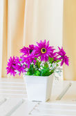 Fake flowers in vase — Stock Photo