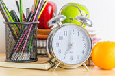 Note books , clock , pencils , apples — Foto Stock