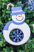 Snowman on christmas tree — Стоковое фото