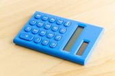 Calculator on wood table — Stock Photo