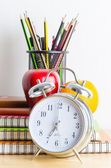 Note books, clock, pencils, apples — Stock Photo