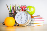 Note book , clock , pencils , apples — Foto Stock