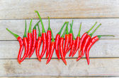 Chilli on wood background — Stock Photo