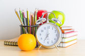 Note book , clock , pencils , apples — Stock Photo