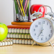 Note books, clock, pencils, apples — Stock Photo #41242535