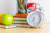 Note books, clock, pencils, apples — Stock Photo