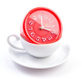 White cup and clock — Stock Photo