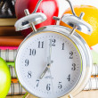 Note book, clock, pencils, apples — Stock Photo #41553745