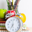 Note book, clock, pencils, apples — Stock Photo #41553801