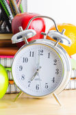 Note book, clock, pencils, apples — Stock Photo