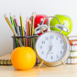 Note book, clock, pencils, apples — Stock Photo #41857133