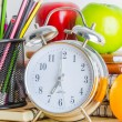 Note book, clock, pencils, apples — Stock Photo #41857267