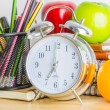 Note book, clock, pencils, apples — Stock Photo #41857273