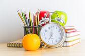 Note book, clock, pencils, apples — Stock Photo