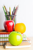 Note books,  pencils, apples on the table — Stock Photo