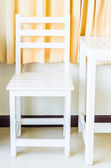 White wood table and chair — Stock Photo