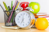 Note books, clock, pencils, apples on the table — Foto Stock