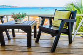 Wood chairs on the beach — Stock Photo