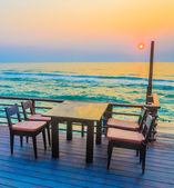 Dinner table and chairs — Stock Photo
