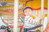 Child on the carousel horse — Foto de Stock