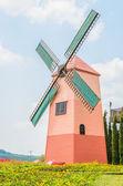 Windmill in the garden — Stock Photo