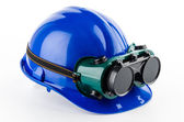 Safety helmet and goggles — Stock Photo