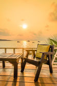 Wood chair sunset on the beach — Stock Photo