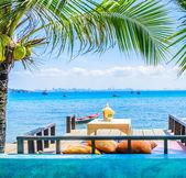 Table on the beach — Stock Photo