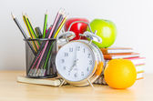 Back to school , note book , clock , pencil , apple on wood tabl — Foto de Stock