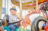 Children play carousel horse — Stockfoto