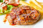 Barbecue grilled pork steak — Stock Photo