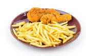 French fries and fried chicken isolated white background — Stock Photo