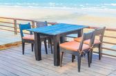 Dinner table on beach — Stock Photo