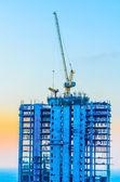 Crane construction twilight times — Stockfoto