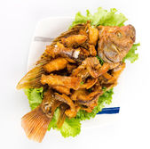 Thai food fried fish in white plate isolated on white background — Stock Photo