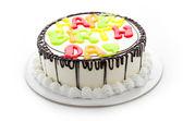 Happy birthday cake isolated on white — Stock Photo