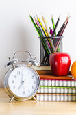 Back to school , note book , clock , pencil , apple on wood tabl — Stock Photo
