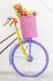 Bicycle with basket fruit and flower — Stock Photo