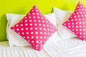Colorful polka pillows — Stock Photo